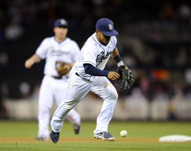Sep 25, 2013; San Diego, CA, USA; San Diego Padres shortstop Alexi Amarista (5) bobbles a ball on a play during the seventh inning against the Arizona Diamondbacks at Petco Park. Mandatory Credit: Christopher Hanewinckel-USA TODAY Sports