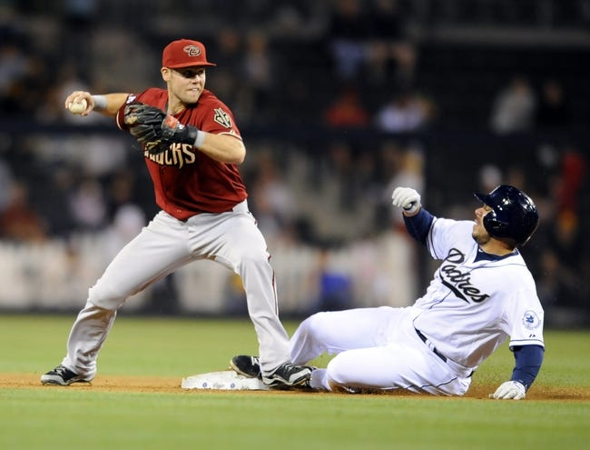 Sep 25, 2013; San Diego, CA, USA; Arizona Diamondbacks shortstop Chris Owings (16) records a force out at second ahead of the slide by San Diego Padres catcher Rene Rivera (44) during the fifth inning against the San Diego Padres at Petco Park. Mandatory Credit: Christopher Hanewinckel-USA TODAY Sports