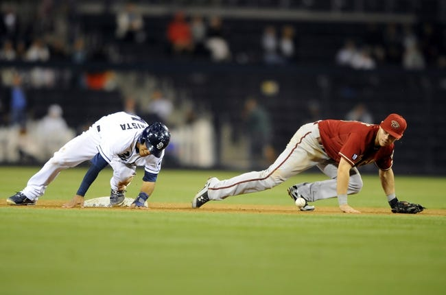 Sep 25, 2013; San Diego, CA, USA; San Diego Padres center fielder Alexi Amarista (5) slides safely into second base as Arizona Diamondbacks shortstop Chris Owings (16) loses control of the ball during the eighth inning at Petco Park. Mandatory Credit: Christopher Hanewinckel-USA TODAY Sports
