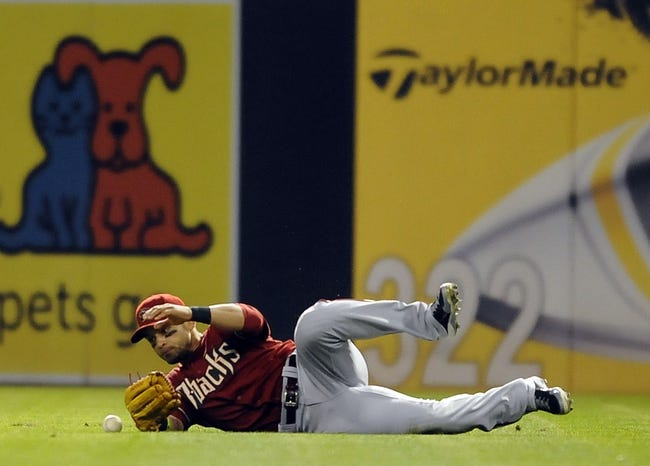 Sep 25, 2013; San Diego, CA, USA; Arizona Diamondbacks center fielder Gerardo Parra (8) is unable to make a sliding catch during the eighth inning against the San Diego Padres at Petco Park. Mandatory Credit: Christopher Hanewinckel-USA TODAY Sports