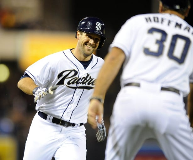 Sep 25, 2013; San Diego, CA, USA; San Diego Padres pinch hitter Chris Robinson (8) is congratulated by third base coach Glenn Hoffman (30) following his first major league hit, a home run in the eighth inning, against the Arizona Diamondbacks at Petco Park. Mandatory Credit: Christopher Hanewinckel-USA TODAY Sports