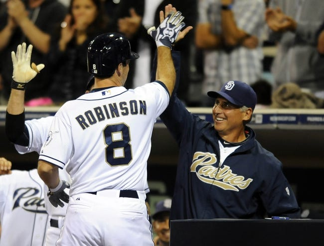 Sep 25, 2013; San Diego, CA, USA; San Diego Padres pinch hitter Chris Robinson (8) is congratulated by manager Bud Black (20) following his first major league hit, a home run in the eighth inning, against the Arizona Diamondbacks at Petco Park. Mandatory Credit: Christopher Hanewinckel-USA TODAY Sports