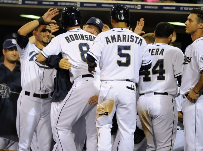 Sep 25, 2013; San Diego, CA, USA; San Diego Padres pinch hitter Chris Robinson (8) is congratulated by teammates following his first major league hit, a home run in the eighth inning, against the Arizona Diamondbacks at Petco Park. Mandatory Credit: Christopher Hanewinckel-USA TODAY Sports