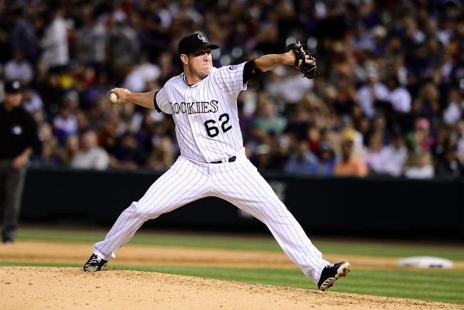 Sep 25, 2013; Denver, CO, USA; Colorado Rockies relief pitcher Rob Scahill (62) delivers a pitch in the fifth inning of the game against the Boston Red Sox at Coors Field. Mandatory Credit: Ron Chenoy-USA TODAY Sports