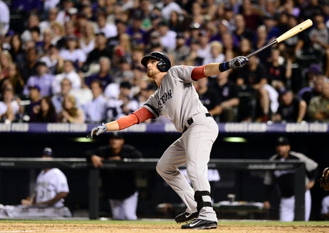 Sep 25, 2013; Denver, CO, USA; Boston Red Sox third baseman Will Middlebrooks (16) follows his home run in the eighth inning against the Colorado Rockies at Coors Field. The Red Sox defeated the Rockies 15-5. Mandatory Credit: Ron Chenoy-USA TODAY Sports