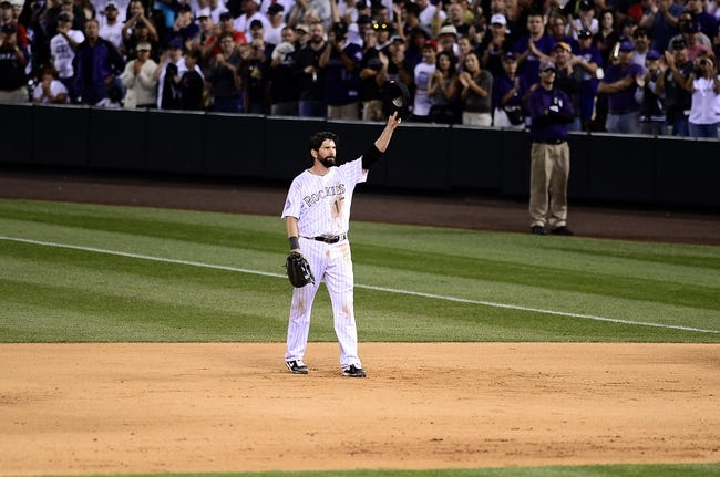 Sep 25, 2013; Denver, CO, USA; Colorado Rockies first baseman Todd Helton (17) tips his hat to the crowd at the top of the ninth inning against the Boston Red Sox at Coors Field. The Red Sox defeated the Rockies 15-5. Mandatory Credit: Ron Chenoy-USA TODAY Sports