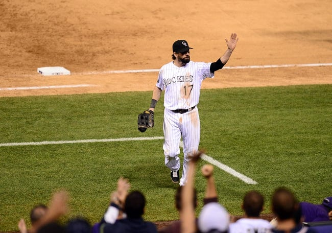 Sep 25, 2013; Denver, CO, USA; Colorado Rockies first baseman Todd Helton (17) waves to the crowd following the loss to the Boston Red Sox at Coors Field. The Red Sox defeated the Rockies 15-5. Mandatory Credit: Ron Chenoy-USA TODAY Sports
