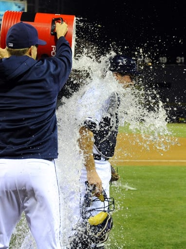 Sep 25, 2013; San Diego, CA, USA; San Diego Padres catcher Chris Robinson (8) is dumped with water by teammates Nick Hundley (left) and Logan Forsythe (back) after a 12-2 win against the Arizona Diamondbacks at Petco Park. Mandatory Credit: Christopher Hanewinckel-USA TODAY Sports