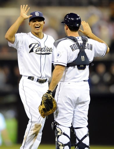 Sep 25, 2013; San Diego, CA, USA; SSan Diego Padres center fielder Will Venable (25) celebrates with catcher Chris Robinson (8) after a 12-2 win against the Arizona Diamondbacks at Petco Park. Mandatory Credit: Christopher Hanewinckel-USA TODAY Sports