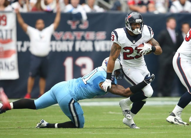 Sep 15, 2013; Houston, TX, USA; Houston Texans running back Arian Foster (23) runs with the ball against the Tennessee Titans at Reliant Stadium. Mandatory Credit: Matthew Emmons-USA TODAY Sports
