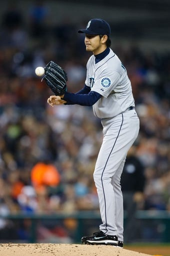 Sep 18, 2013; Detroit, MI, USA; Seattle Mariners starting pitcher Hisashi Iwakuma (18) during the game against the Detroit Tigers at Comerica Park. Mandatory Credit: Rick Osentoski-USA TODAY Sports