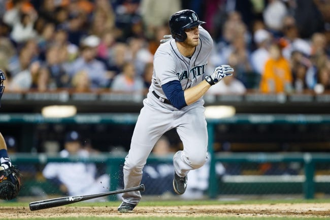 Sep 18, 2013; Detroit, MI, USA; Seattle Mariners center fielder Michael Saunders (55) runs to first against the Detroit Tigers at Comerica Park. Mandatory Credit: Rick Osentoski-USA TODAY Sports