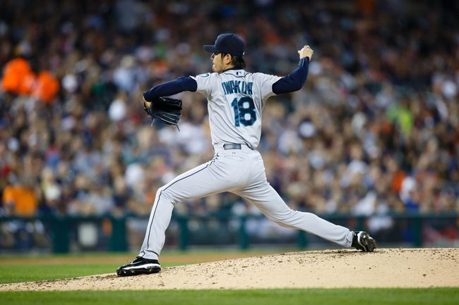 Sep 18, 2013; Detroit, MI, USA; Seattle Mariners starting pitcher Hisashi Iwakuma (18) pitches against the Detroit Tigers at Comerica Park. Mandatory Credit: Rick Osentoski-USA TODAY Sports