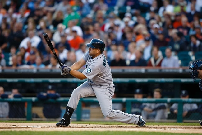 Sep 18, 2013; Detroit, MI, USA; Seattle Mariners designated hitter Kendrys Morales (8) at bat against the Detroit Tigers at Comerica Park. Mandatory Credit: Rick Osentoski-USA TODAY Sports