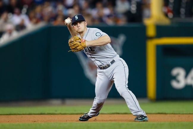 Sep 18, 2013; Detroit, MI, USA; Seattle Mariners third baseman Kyle Seager (15) makes a throw against the Detroit Tigers at Comerica Park. Mandatory Credit: Rick Osentoski-USA TODAY Sports