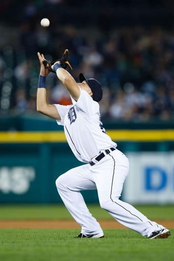 Sep 18, 2013; Detroit, MI, USA; Detroit Tigers second baseman Omar Infante (4) makes a catch against the Seattle Mariners at Comerica Park. Mandatory Credit: Rick Osentoski-USA TODAY Sports