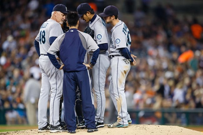 Sep 18, 2013; Detroit, MI, USA; Seattle Mariners pitching coach Carl Willis (48) talks to starting pitcher Hisashi Iwakuma (18) against the Detroit Tigers at Comerica Park. Mandatory Credit: Rick Osentoski-USA TODAY Sports
