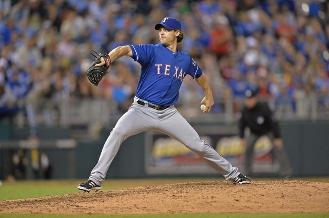Sep 20, 2013; Kansas City, MO, USA; Texas Rangers pitcher Neal Cotts (56) delivers a pitch against the Kansas City Royals during the sixth inning at Kauffman Stadium. Mandatory Credit: Peter G. Aiken-USA TODAY Sports