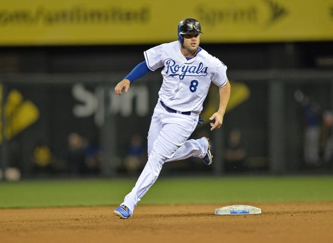 Sep 20, 2013; Kansas City, MO, USA; Kansas City Royals third basemen Mike Moustakas (8) rounds second base against the Texas Rangers during the fourth inning at Kauffman Stadium. Mandatory Credit: Peter G. Aiken-USA TODAY Sports
