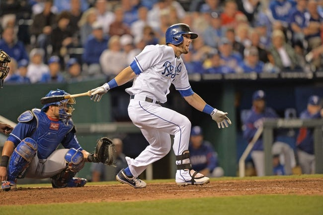 Sep 20, 2013; Kansas City, MO, USA; Kansas City Royals left fielder Alex Gordon (4) at bat against the Texas Rangers during the seventh inning at Kauffman Stadium. Mandatory Credit: Peter G. Aiken-USA TODAY Sports