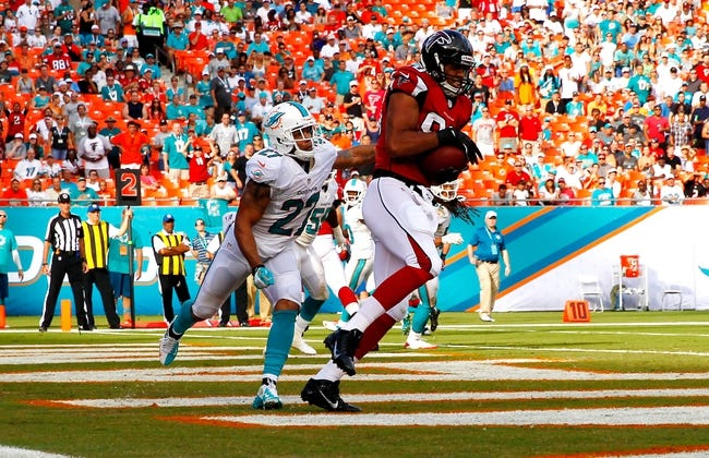 Sep 22, 2013; Miami Gardens, FL, USA; Atlanta Falcons tight end Levine Toilolo (80) catches a touchdown pass as Miami Dolphins safety Jimmy Wilson (27) tries to defend in the second half at Sun Life Stadium. Miami won 27-23. Mandatory Credit: Robert Mayer-USA TODAY Sports