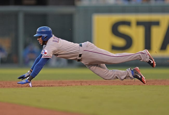 Sep 21, 2013; Kansas City, MO, USA; Texas Rangers shortstop Elvis Andrus (1) dives into second on an attempted steal against the Kansas City Royals during the third inning at Kauffman Stadium. Mandatory Credit: Peter G. Aiken-USA TODAY Sports