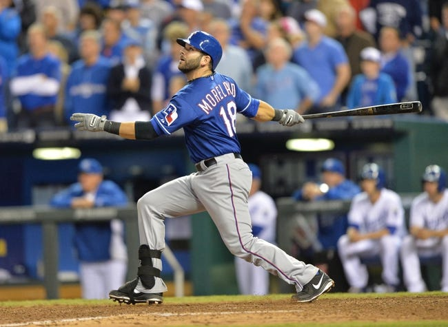 Sep 20, 2013; Kansas City, MO, USA; Texas Rangers first basemen Moreland (18) at bat against the Kansas City Royals during the ninth inning at Kauffman Stadium. Mandatory Credit: Peter G. Aiken-USA TODAY Sports