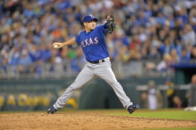 Sep 20, 2013; Kansas City, MO, USA; Texas Rangers pitcher Jason Frasor (44) delivers a pitch against the Kansas City Royals during the eighth inning at Kauffman Stadium. Mandatory Credit: Peter G. Aiken-USA TODAY Sports