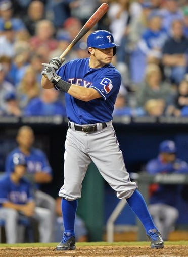 Sep 20, 2013; Kansas City, MO, USA; Texas Rangers second basemen Ian Kinsler (5) at bat against the Kansas City Royals during the third inning at Kauffman Stadium. Mandatory Credit: Peter G. Aiken-USA TODAY Sports