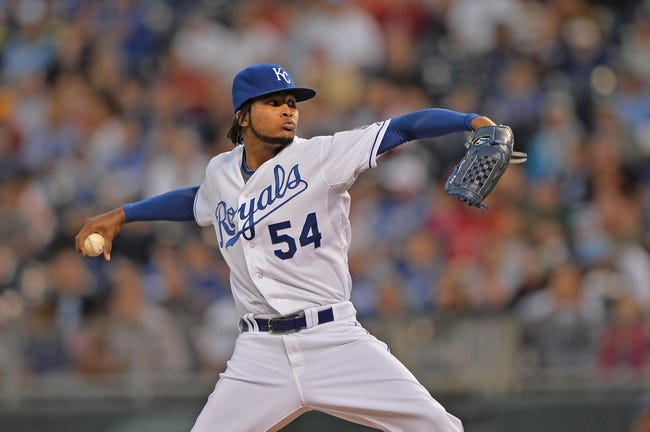 Sep 20, 2013; Kansas City, MO, USA; Kansas City Royals pitcher Ervin Santana (54) delivers a pitch against the Texas Rangers during the first inning at Kauffman Stadium. Mandatory Credit: Peter G. Aiken-USA TODAY Sports