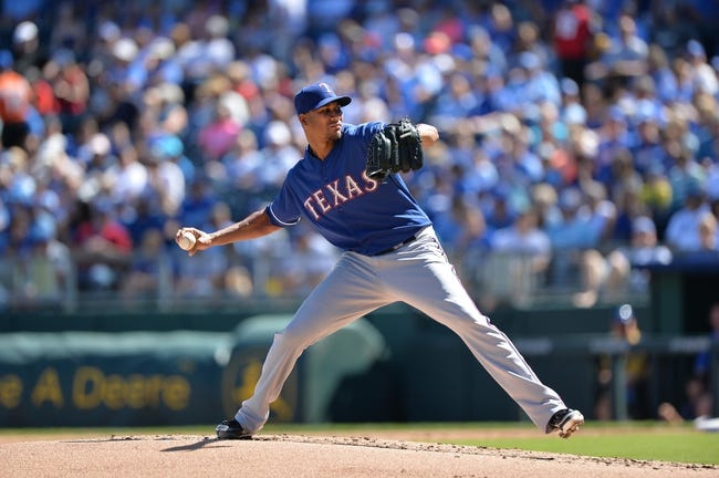 Sep 22, 2013; Kansas City, MO, USA; Texas Rangers pitcher Alexi Ogando (41) delivers a pitch against the Kansas City Royals during the first inning at Kauffman Stadium. Mandatory Credit: Peter G. Aiken-USA TODAY Sports
