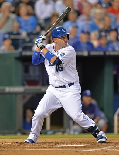 Sep 20, 2013; Kansas City, MO, USA; Kansas City Royals designated hitter Billy Butler (16) at bat against the Texas Rangers during the first inning at Kauffman Stadium. Mandatory Credit: Peter G. Aiken-USA TODAY Sports