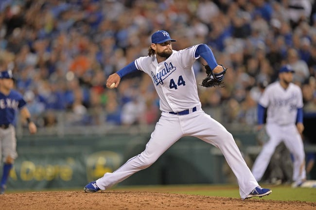 Sep 20, 2013; Kansas City, MO, USA; Kansas City Royals pitcher Luke Hochevar (44) delivers a pitch against the Texas Rangers during the eighth inning at Kauffman Stadium. Mandatory Credit: Peter G. Aiken-USA TODAY Sports