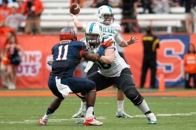 Sep 21, 2013; Syracuse, NY, USA; Tulane Green Wave guard Nathan Shienle (66) blocks Syracuse Orange linebacker Marquis Spruill (11) to protect his quarterback Nick Montana (11) during the second quarter of a game at the Carrier Dome. Syracuse won the game 52-17. Mandatory Credit: Mark Konezny-USA TODAY Sports