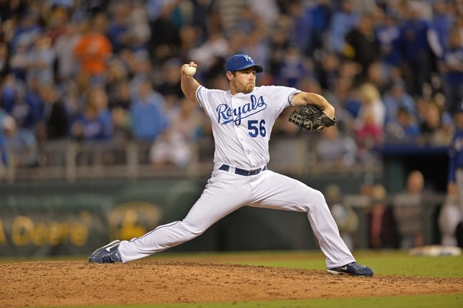 Sep 20, 2013; Kansas City, MO, USA; Kansas City Royals pitcher Greg Holland (56) delivers a pitch against the Texas Rangers during the ninth inning at Kauffman Stadium. Mandatory Credit: Peter G. Aiken-USA TODAY Sports