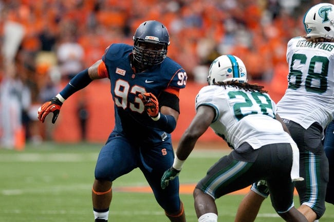 Sep 21, 2013; Syracuse, NY, USA; Syracuse Orange defensive end Micah Robinson (93) looks to get past the block of Tulane Green Wave running back Rob Kelley (28) during the second quarter of a game at the Carrier Dome. Syracuse won the game 52-17. Mandatory Credit: Mark Konezny-USA TODAY Sports
