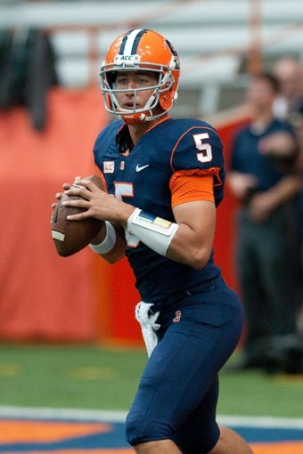 Sep 21, 2013; Syracuse, NY, USA; Syracuse Orange quarterback Austin Wilson (5) warms up prior to a game against the Tulane Green Wave at the Carrier Dome. Mandatory Credit: Mark Konezny-USA TODAY Sports