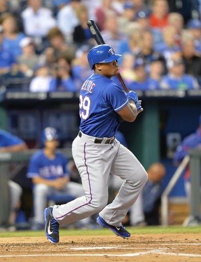 Sep 20, 2013; Kansas City, MO, USA; Texas Rangers third basemen Adrian Beltre (29) at bat against the Kansas City Royals during the second inning at Kauffman Stadium. Mandatory Credit: Peter G. Aiken-USA TODAY Sports