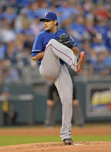 Sep 20, 2013; Kansas City, MO, USA; Texas Rangers pitcher Martin Perez (33) delivers a pitch against the Kansas City Royals during the first inning at Kauffman Stadium. Mandatory Credit: Peter G. Aiken-USA TODAY Sports