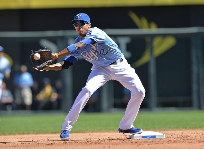 Sep 22, 2013; Kansas City, MO, USA; Kansas City Royals shortstop Alcides Escobar (2) reaches for the ball for a force out at second against the Texas Rangers during the second inning at Kauffman Stadium. Mandatory Credit: Peter G. Aiken-USA TODAY Sports