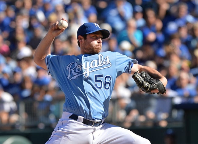 Sep 22, 2013; Kansas City, MO, USA; Kansas City Royals pitcher Greg Holland (56) delivers a pitch against the Texas Rangers during the ninth inning at Kauffman Stadium. Mandatory Credit: Peter G. Aiken-USA TODAY Sports