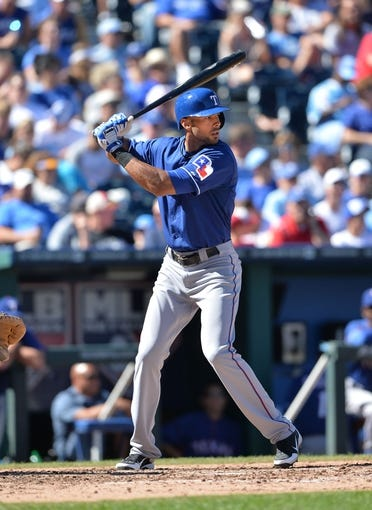Sep 22, 2013; Kansas City, MO, USA; Texas Rangers right fielder Alex Rios (51) at bat against the Kansas City Royals during the fifth inning at Kauffman Stadium. Mandatory Credit: Peter G. Aiken-USA TODAY Sports