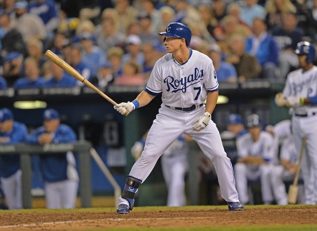 Sep 20, 2013; Kansas City, MO, USA; Kansas City Royals right fielder David Lough (7) at bat against the Texas Rangers during the eighth inning at Kauffman Stadium. Mandatory Credit: Peter G. Aiken-USA TODAY Sports