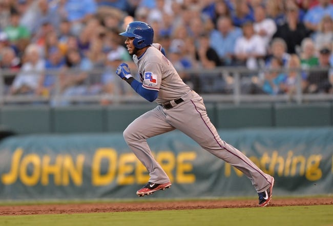 Sep 21, 2013; Kansas City, MO, USA; Texas Rangers shortstop Elvis Andrus (1) runs to second on an attempted steal against the Kansas City Royals during the third inning at Kauffman Stadium. Mandatory Credit: Peter G. Aiken-USA TODAY Sports