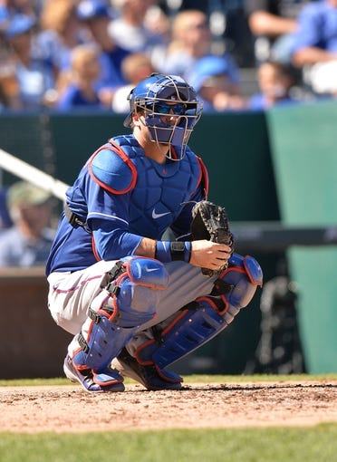 Sep 22, 2013; Kansas City, MO, USA; Texas Rangers catcher A.J. Pierzynski (12) gets set behind home plat against the Kansas City Royals during the fourth inning at Kauffman Stadium. Mandatory Credit: Peter G. Aiken-USA TODAY Sports