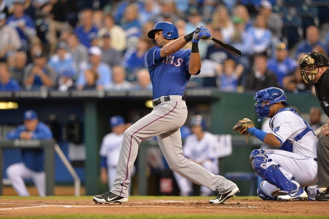 Sep 20, 2013; Kansas City, MO, USA; Texas Rangers right fielder Alex Rios (51) at bat against the Kansas City Royals during the first inning at Kauffman Stadium. Mandatory Credit: Peter G. Aiken-USA TODAY Sports