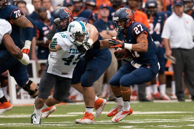 Sep 21, 2013; Syracuse, NY, USA; Syracuse Orange running back George Morris II (27) looks to get past Tulane Green Wave linebacker Matthew Bailey (45) in the fourth quarter of a game at Carrier Dome. Syracuse won the game 52-17. Mandatory Credit: Mark Konezny-USA TODAY Sports