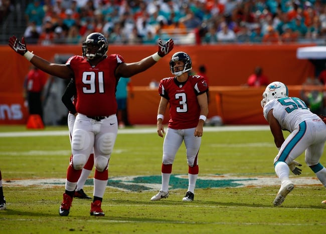 Sep 22, 2013; Miami Gardens, FL, USA; Atlanta Falcons defensive tackle Corey Peters (91) reacts to a field goal by kicker Matt Bryant (3) in the first quarter of a game against the Miami Dolphins at Sun Life Stadium. Mandatory Credit: Robert Mayer-USA TODAY Sports