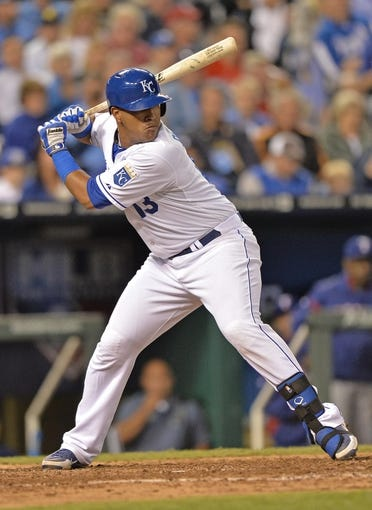 Sep 20, 2013; Kansas City, MO, USA; Kansas City Royals catcher Salvador Perez (13) at bat against the Texas Rangers during the fourth inning at Kauffman Stadium. Mandatory Credit: Peter G. Aiken-USA TODAY Sports