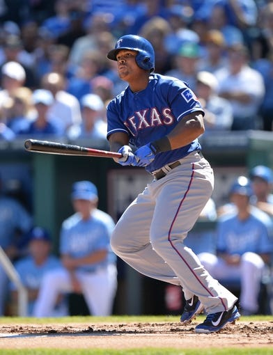 Sep 22, 2013; Kansas City, MO, USA; Texas Rangers third basemen Adrian Beltre (29) at bat against the Kansas City Royals during the second inning at Kauffman Stadium. Mandatory Credit: Peter G. Aiken-USA TODAY Sports